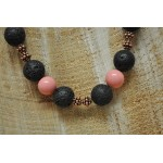 Long Peach shell pearl and black lava beads with fancy cooper spacers on a black cord